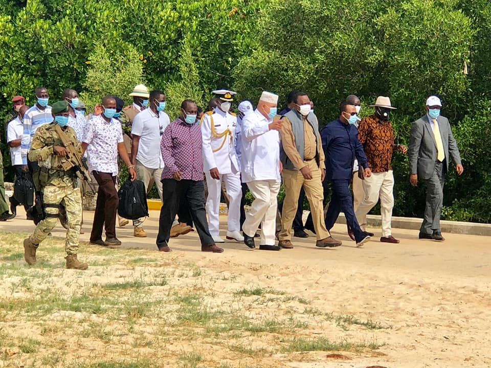 President Uhuru Kenyatta and Ethiopia's Prime Minister Abiy Ahmed alongside a host of other senior government officials at the Manda Airport, Lamu County.